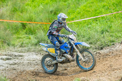 Motocross racer on mud Royalty Free Stock Photos