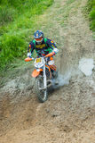 Motocross racer on mud Royalty Free Stock Images