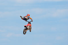 Motocross racer performs a jump Royalty Free Stock Photos