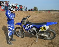Motocross: racer prepares for departure on the route Stock Photography