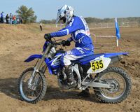 Motocross: racer prepares for departure on the route Royalty Free Stock Photo