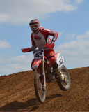 Motocross: racer in red Stock Image