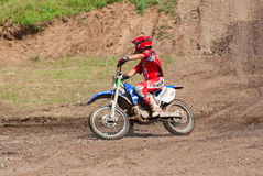Motocross racer rides Royalty Free Stock Images