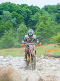 Motocross racer on rocks Royalty Free Stock Photo