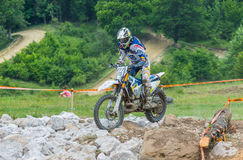 Motocross racer on rocks Stock Photography