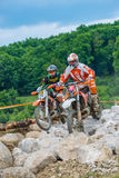 Motocross racer on rocks Stock Image