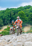 Motocross racer on rocks Stock Images