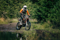 Motocross racer on the track Royalty Free Stock Photos