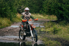 Motocross racer on the track Royalty Free Stock Images