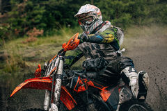 Motocross racer on the track Stock Images