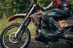 Motocross racer on the track Stock Photos