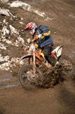 Motocross racer is turning in gauge line with Royalty Free Stock Photos