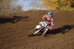 Motocross racer turns with large slope Stock Images