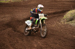 Motocross racer turns with proslipping Royalty Free Stock Photos