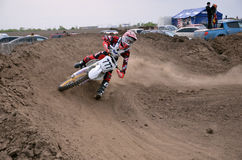 Motocross racer veering with large slope Royalty Free Stock Image