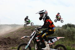 Motocross. Racers above the hill.  championship, event from 25 July 2015, Irbit, Russia royalty free stock photography