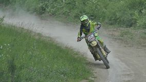 Motocross racers on dirt track, super slow motion stock footage