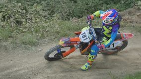 Motocross racers on dirt track, super slow motion stock video footage