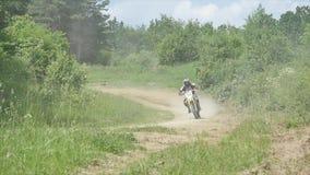 Motocross racers on dirt track, super slow motion stock video