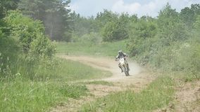 Motocross racers on dirt track, super slow motion.  stock footage