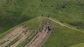 Motocross racers rises to the hill.  stock footage