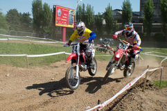 Motocross racers Stock Images