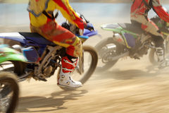 Motocross racing. In dirt track royalty free stock image