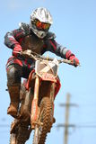 Motocross racing. Motocross competitor in a jump in national event in Puerto Rico Royalty Free Stock Images