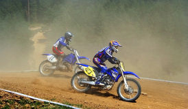 Motocross racing. Two speeding competitors in a fast-paced motocross race in Zarnesti, Romania Royalty Free Stock Photography