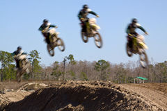 Motocross Racing. Multiple exposer of a motocross rider making a jump stock images