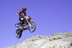 Motocross Racing. A motocross rider airborne during a jump Royalty Free Stock Image