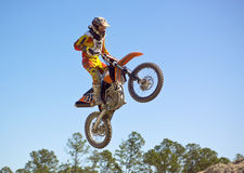 Motocross Racing. A motocross rider airborne after a jump stock photos