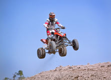 Motocross Racing. A motocross rider airborne after a jump royalty free stock images
