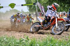 Motocross racing. Motocross challenge in dirty ground Royalty Free Stock Photo