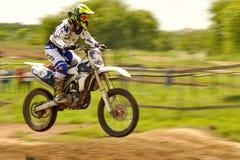 Motocross racing. Motocross challenge in dirty ground Stock Photos