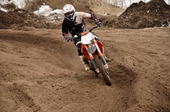 Motocross racing driver at turning Stock Photography