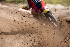 Motocross-Rennstaub-Reiter Stockfotos