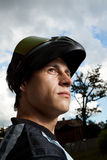 Motocross rider. Portrait of a motocross rider with helmet Stock Images