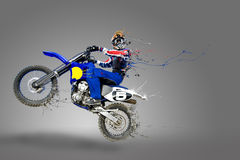 Motocross rider. Man riding his motocross bike with paint detaching all over his bike and body Stock Photos