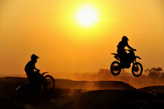 Motocross rider. Action in silhouette royalty free stock photography