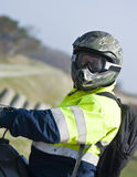 Motocross rider. A motocross rider wearing his protective sportswear - helmet, goggles Royalty Free Stock Photos