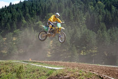 Motocross rider in air. European championship motocross rider in a competition in Zarnesti, Romania Royalty Free Stock Image