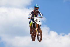 Motocross rider and bike clearing a tabletop jump. During the final heat of the race Royalty Free Stock Photos