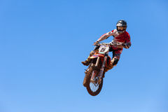 Motocross rider and bike clearing a tabletop jump Stock Image