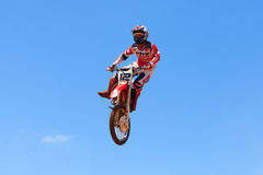 Motocross rider and bike clearing a tabletop jump. During the final heat of the race Stock Photography