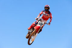 Motocross rider and bike clearing a tabletop jump Royalty Free Stock Image