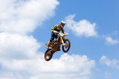 Motocross rider and bike clearing a tabletop jump Stock Photo