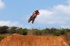Motocross rider and bike clearing a tabletop jump Royalty Free Stock Images