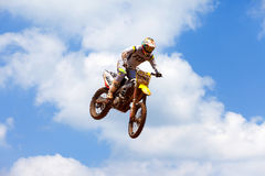 Motocross rider and bike clearing a tabletop jump Stock Photos
