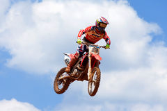 Motocross rider and bike clearing a tabletop jump Royalty Free Stock Photos